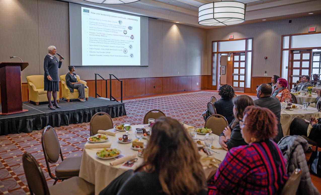 Dr. Holbrook presents PowerPoint at 20th Anniversary Luncheon