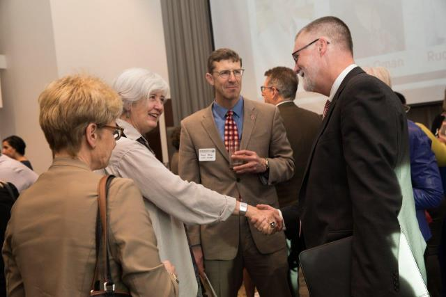 Provost McPherson shaking hands at 2018 reception