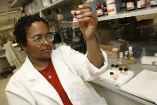 Black woman working in lab