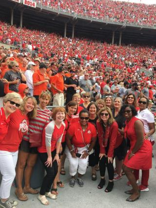 Group of the Glass Breakers at OSU football game with crowd behind them
